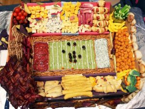 food organized to look like a football field