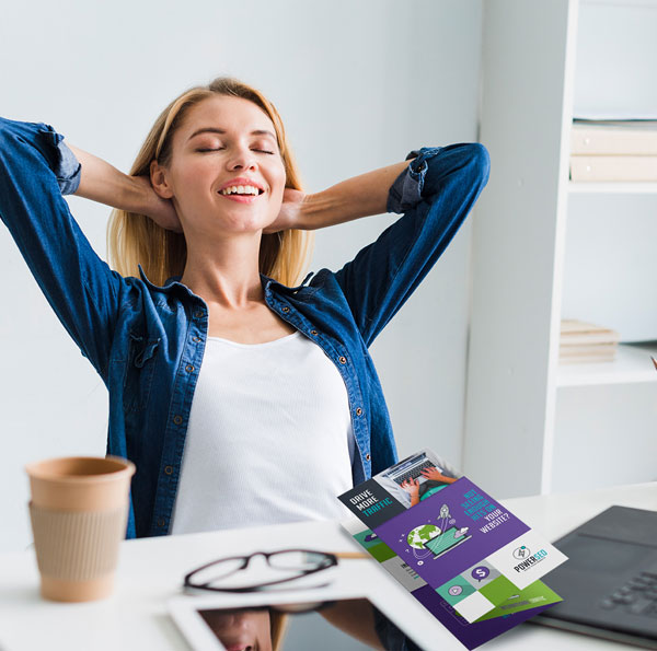 Image shows person satisfied with the accomplishment of a brochure designed and done